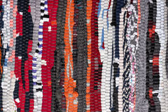 Colorful handmade fabric texture motley rug or carpet Stock Photos