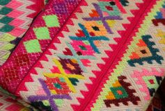 Colorful handmade fabrics at market. Colorful handmade fabrics are for sale at the Ollantaytambo souvenir market in the Sacred Valley in Peru royalty free stock image
