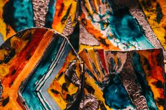 Colorful handmade Italian pottery with bold patterns and hand pa. Inted designs stock photo