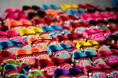 Colorful handmade kids sandals on street market in Thailand stock photography