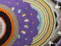 Colorful handmade knitted rugs Stock Photos