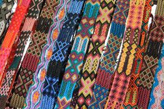 Macrame belts for sale at Mexican craft market Stock Images