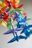 Colorful handmade origami cranes or fantasy birds stock image