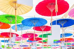Colorful handmade paper umbrella hanging on top stock image