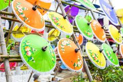 Colorful handmade paper umbrella hanging on top royalty free stock image