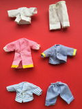 Colorful handmade puppet clothing Stock Photos