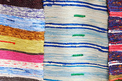 Colorful handmade rugs taken closeup. Stock Photography
