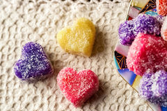 Colorful handmade soap. In the form of heart on a white tablecloth stock image