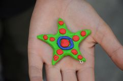 Colorful handmade star in children´s hand Royalty Free Stock Photography