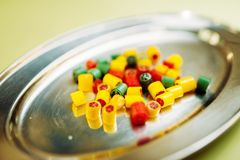 Colorful handmade sugar caramel sweets in plate. Closeup, nobody. Fresh lollipop in candy store Royalty Free Stock Photography