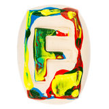 Colorful handmade of white clay letter F Royalty Free Stock Photos