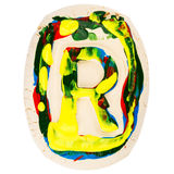 Colorful handmade of white clay letter R Stock Images