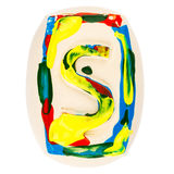 Colorful handmade of white clay letter S Stock Image