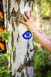 Colorful handprints on a birch tree Royalty Free Stock Images