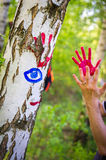 Colorful handprints on a birch tree Royalty Free Stock Image