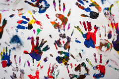 Colorful handprints hands on a white canvas Royalty Free Stock Images