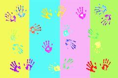 Colorful handprints by kids Stock Photos