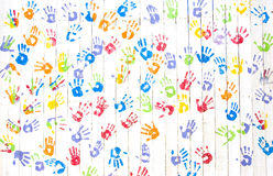 Colorful handprints on a wall Stock Image