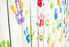 Colorful handprints on wall from an angle Royalty Free Stock Photo