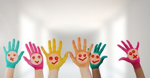 Colorful hands with faces in bright hall. Digital composite of Colorful hands with faces in bright hall Stock Photography