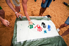 Colorful hands prints. Team of people making handprint on white paper Royalty Free Stock Photos