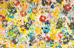 Colorful Hands Prints. Bright and colorful hand prints on a rough texture wall Stock Photography