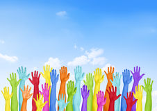 Colorful Hands Raised With Blue Sky Royalty Free Stock Images
