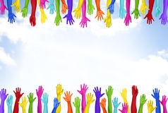 Colorful Hands Raised With Blue Sky Stock Image