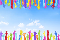 Colorful Hands Raised With Blue Sky Stock Photo
