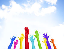 Colorful Hands Raised With Blue Sky Stock Photos