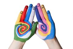 Colorful hands with smiling fingers. Colorful painted hands with smiling fingers royalty free stock photos