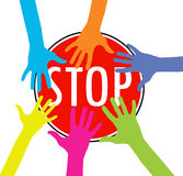 Colorful hands on stop sign Stock Photography