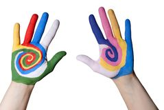 Colorful hands. Two hands painted with many colors symbolizing joy, isolated royalty free stock photography