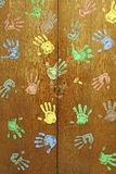 Colorful hands on wardrobe Stock Photography