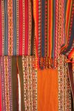 Colorful handwoven fabrics at the market. Colorful handwoven fabrics are on display at the Urubamba souvenir market in the Sacred Valley in Peru royalty free stock image