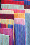 Colorful handwoven textiles. On a rack Royalty Free Stock Images