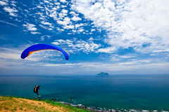 Colorful hang glider in sky Royalty Free Stock Photo