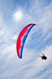 Colorful hang glider in sky Royalty Free Stock Image