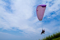 Colorful hang glider in sky Royalty Free Stock Images