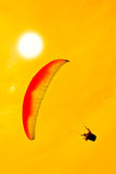 Colorful hang glider in sky Stock Photo