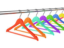 Colorful hangers on clothes rail Royalty Free Stock Images