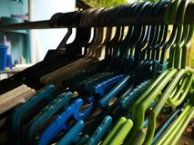 Hanger for cloths and home aludnry. Colorful hangers for home laundry stock photo