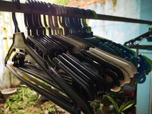 Hanger for cloths and home aludnry. Colorful hangers for home laundry royalty free stock photos