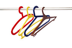 Hanger. Colorful hangers with no clothes in the amount of four pieces on a white background Royalty Free Stock Image
