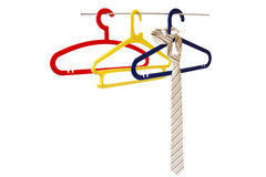 Hanger with tie. Colorful hangers and tie in the number of three pieces on white background Stock Photo