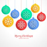 Colorful hanging christmas balls background with snowflakes Royalty Free Stock Photos