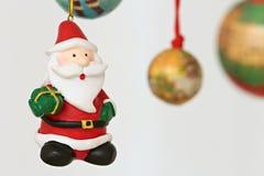 Colorful hanging christmas decorations santa Stock Photo