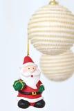 Colorful hanging christmas decorations santa Royalty Free Stock Image
