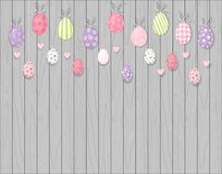 Colorful hanging easter eggs. Rustic wooden background. Cartoon style. N Royalty Free Stock Image