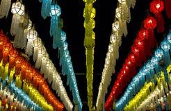 Colorful hanging lanterns lighting on night sky stock photo